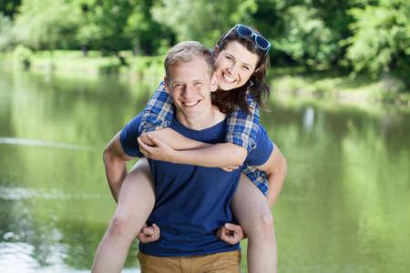 Portrait of happy couple over the lake photo