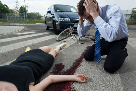 accident dead: Horizontal view of a driver killed young female cyclist  Stock Photo