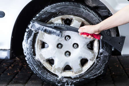 hubcap: Horizontal view of a professional hubcap cleaning Stock Photo