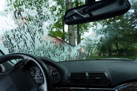 windscreen: View of man working in a car wash Stock Photo