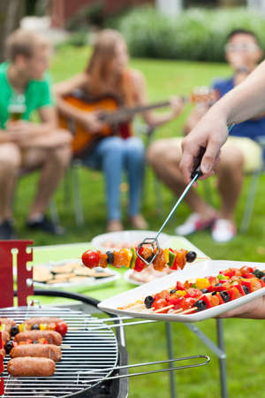 Party in a garden during summer, vertical