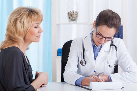 Middle aged woman during medical appointment, horizontal