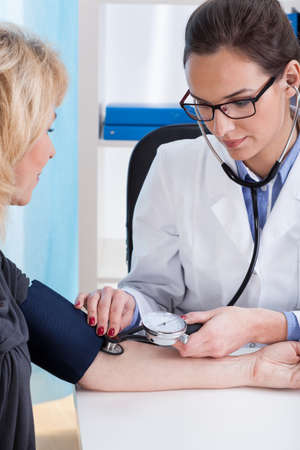 blood pressure gauge: Professional pulse and blood pressure examine in medical clinic
