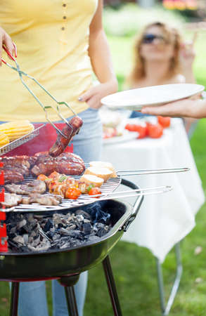 Friends In Home Garden Grilling Meat And Having Fun - Group Of ...