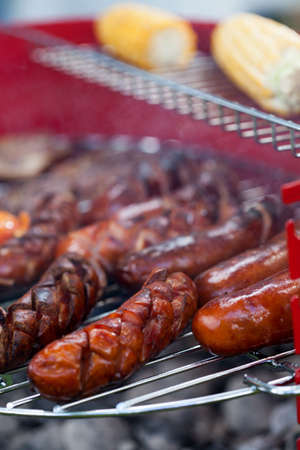 barbecue party: Vertical view of sausages on a grill