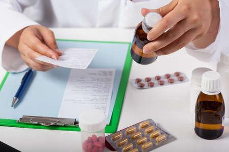 Horizontal view of pharmacist working in pharmacy Stock fotó