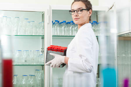 Horizontal view of scientist cleaning the laboratory photo