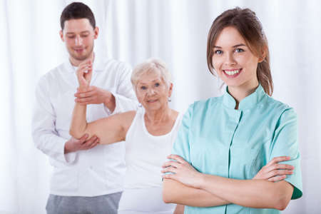 physical test: Elder woman exercising with her physical therapist Stock Photo