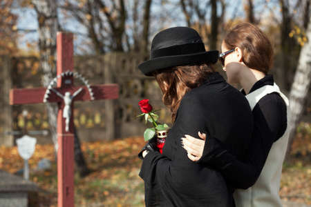 widow: Woman supporting friend in mourning after husband loss.