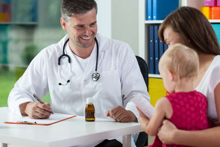 doctor appointment: Mother with daughter during medical appointment, horizontal