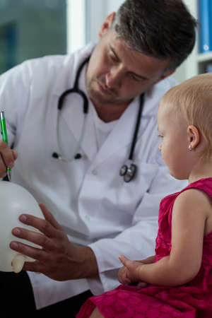 View of little girl and her pediatrician