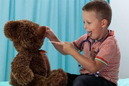 Little boy having fun at pediatricians office photo