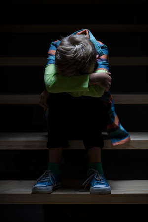 child poverty: View of boy feeling lonely at night