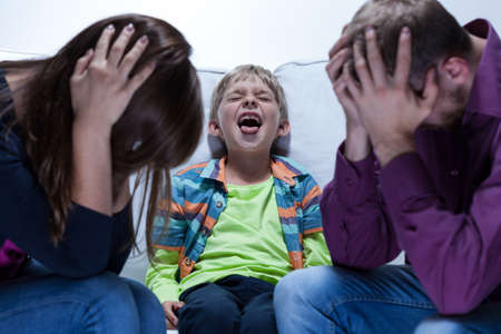 View of yelling boy with educational problems Stock Photo