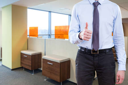 Office worker in suit with thumb up photo