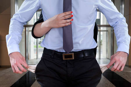 empty pockets: An office worker showing his empty pockets