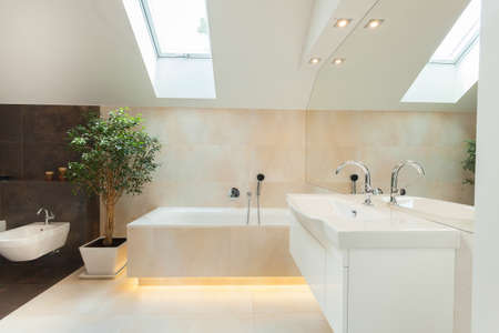 Beautiful modern bathroom with big illuminated bathtube Archivio Fotografico