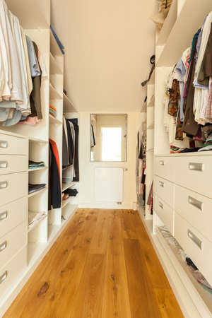 walk in closet: View of bright spacious closet in modern house Stock Photo