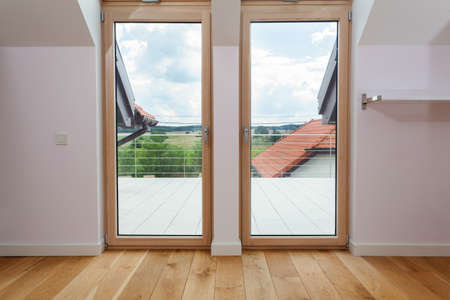 Double door to a terrace with beautiful view photo