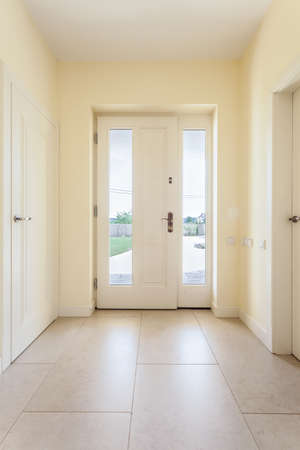 Bright clean corridor with window door in modern house Stock Photo