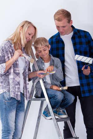flannel: Child choosing a color to paint a room, vertical