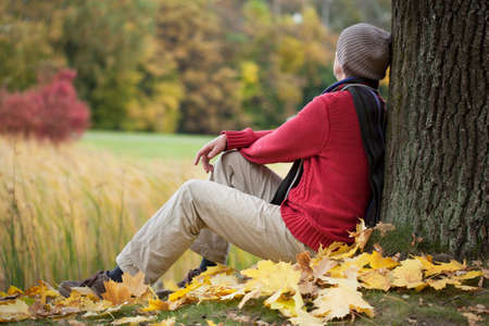 contemplative: Man sitting in the park and contemplating