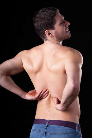 Man with pain of lower part of backbone photo