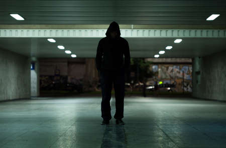 View of dangerous man walking at night