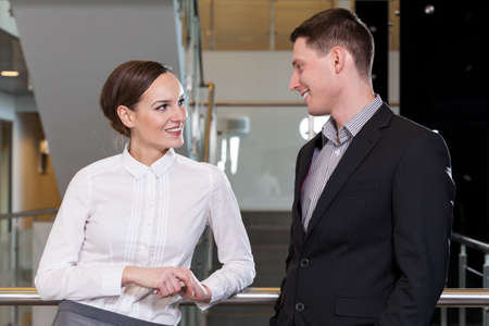 Image of businesswoman flirting with her workmate photo