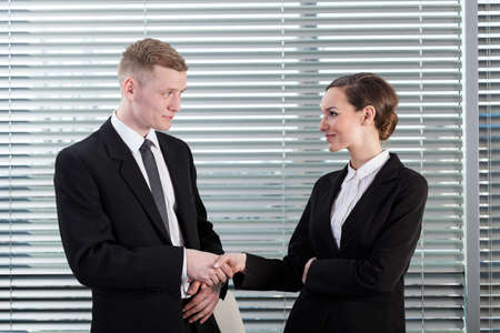 workmate: Man holding by the hand his attractive workmate Stock Photo