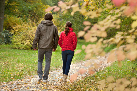 couple WALKING: Happy couple resting and walking in autumn forest