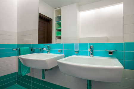 bathroom equipment: Interior of white bathroom with blue elements Stock Photo