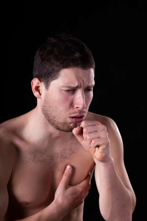 Cold man with sore throat and bronchitis Stock Photo