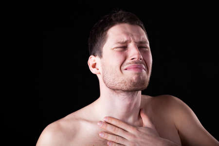 pharyngitis: Horizontal view of man with sore throat