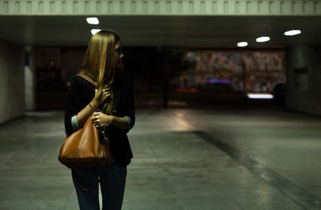 mugger: View of lonely woman in the underpass