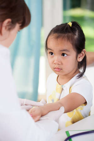 child patient: View of scared asian girl before vaccine
