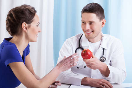 Doctor encouraging young patient to health lifestyle photo