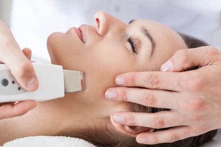 Close-up of woman having cavitation peeling, horizontal photo