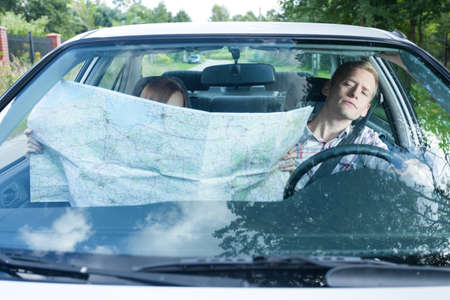 Woman with a map in a car photo