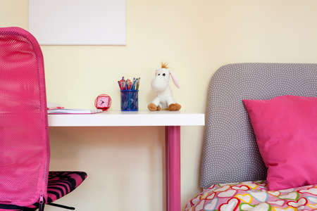 Close-up of kids room with study desk and bed photo