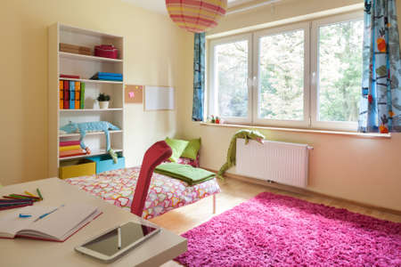 Interior of a children room with big window photo