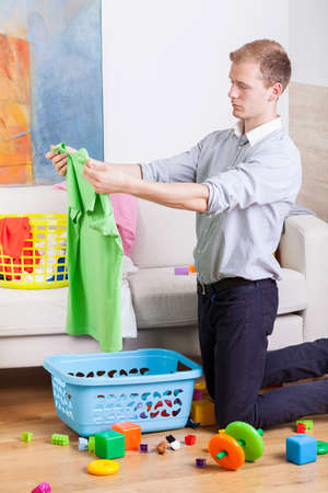 Vertical view of working man cleaning house photo