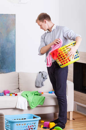 laundry room: Working father before doing laundry at home