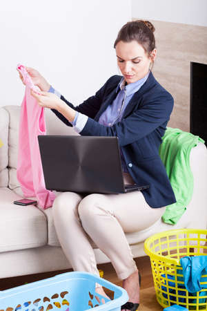 Vertical view of a overworked young businesswoman at home photo