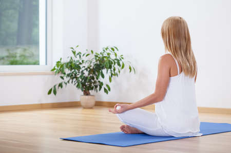 body care: Horizontal view of woman relaxing with yoga Stock Photo
