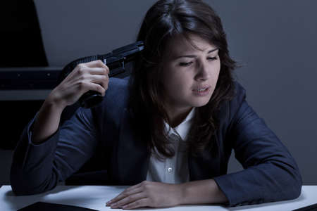 to commit: Businesswomans going to commit suicide in the office