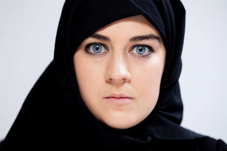 Close-up of scared muslim woman in headscarf photo
