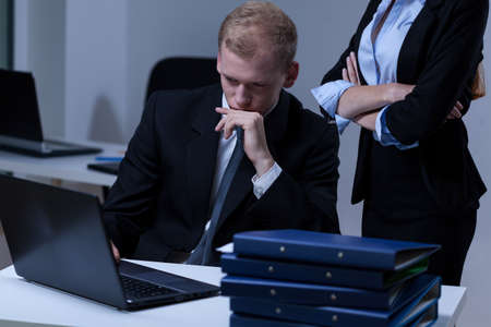 subservience: Young female boss checking his young attractive worker