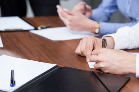 management meeting: Businessman writting new plan sitting at the table Stock Photo