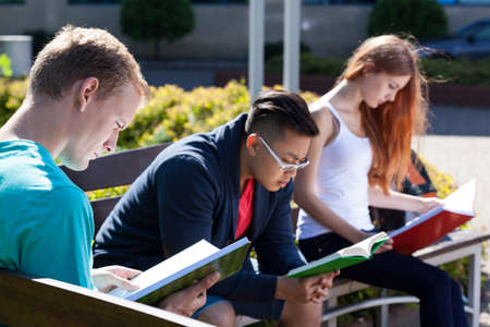 diverse students: View of diverse students on a bench Stock Photo